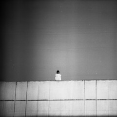 until the dreamers reveal themselves at dusk (memetic) Tags: china bw white girl square concrete blackwhite dress candid dalian delta stranger  minimalism ilford minimalist 30x30 p6  pentaconsix xinghai