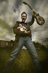 April 14th 2008 - Daddy Rocks (Stephen Poff) Tags: baby rock zoe infant guitar alabama stephen montgomery lespaul pikeroad poff 365days strobist 365icon 365icon608
