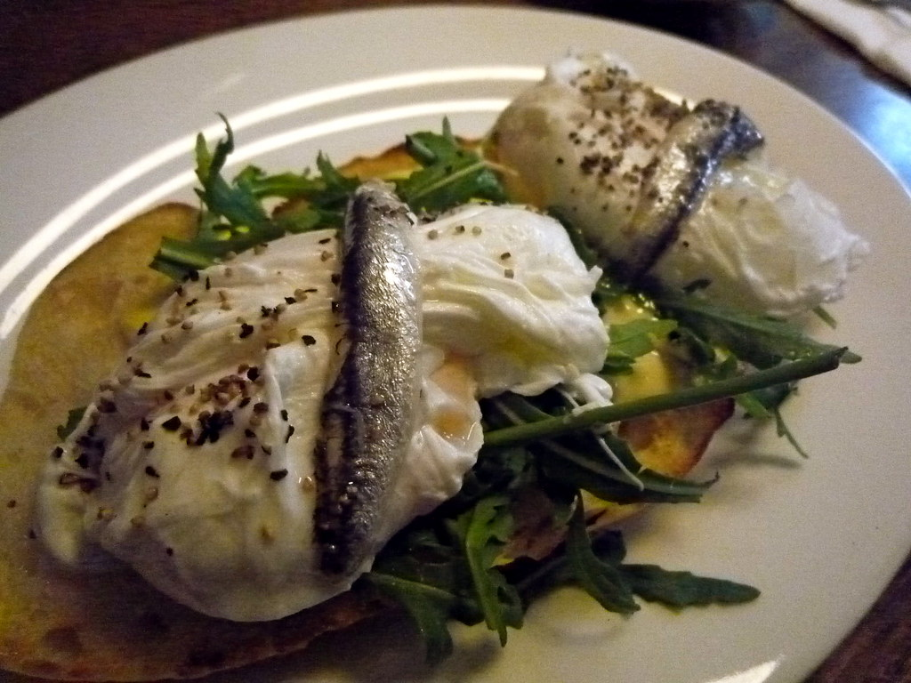 Poached egg, white anchovy, aioli and rocket on toasted panino