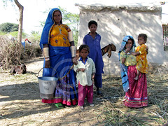 ITS ALL ABOUT LIVING... (S.M.Rafiq) Tags: life family pakistan red portrait woman house history water girl beauty lady rural portraits shopping children design necklace women asia village child dress desert faces traditional villages daily desi hopes historical everyone jewlery hindu sindh thar bangles fetching bangels rajhastan dester tasks badin thardesert cholistan villag smrafiq portraitsportrait itsallaboutliving ruralwome