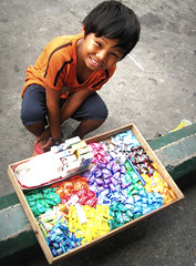mr. candyman (life begins with 4t) Tags: travel boy art beautiful canon kid child philippines vendor cigarettes candies streetchildren streeturchin 4t top20childrensportraits theunforgettablepictures theperfectphotographer spiritofphotography yourcountry