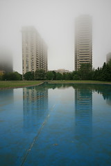 Another Gloomy Day, David Balfour Park, Toronto (Tony Lea) Tags: park street urban mist toronto ontario canada man david pool st fog canon lens rebel reflecting high afternoon gloomy apartment angle grim towers wide foggy sigma dreary wideangle tony reservoir east made ave highrise lea anthony manmade ravine mm yonge rise 1020mm 1020 clair 2009 suites rosehill drizzle rosedale sloppy inclement balfour xti tonylea anthonylea