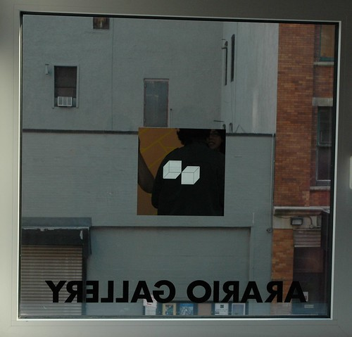 Mirrored Works by Aakash Nihalani on the windows of Arario