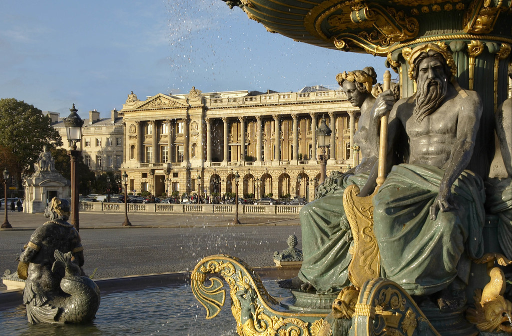 Magnificent fountain of the Place de la Concorde with the Hôtel de Crillon Paris in France as background