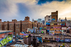 Rooftops of New York (Jim Boud) Tags: light sunset urban streetart newyork art rooftop skyline clouds writing canon buildings landscape evening mural colorful downtown artist apartments cityscape grafitti skyscrapers dusk manhattan dramatic wideangle tags spray spraypaint aerosol tagging ghetto 15mm spraycan lightroom artisticphotography grafites jimboud 1585mm canoneos60d jamesboud canonefs1585mmf3556isusm