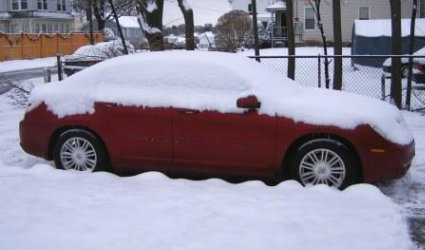 Snow and Ice Covered Car