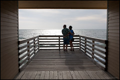 The World in a Box (TomisTaken) Tags: wood sea people woman man beach water silhouette couple view florida deck embrace clearwater