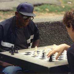 chess player (Frizztext) Tags: reflection square glasses manhattan existentialism chess galleries washingtonsquare chessplayer 500x500 frizztext