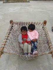jhoola (tango 48) Tags: pakistan boy red girl kids bed islamabad taxila charpoy