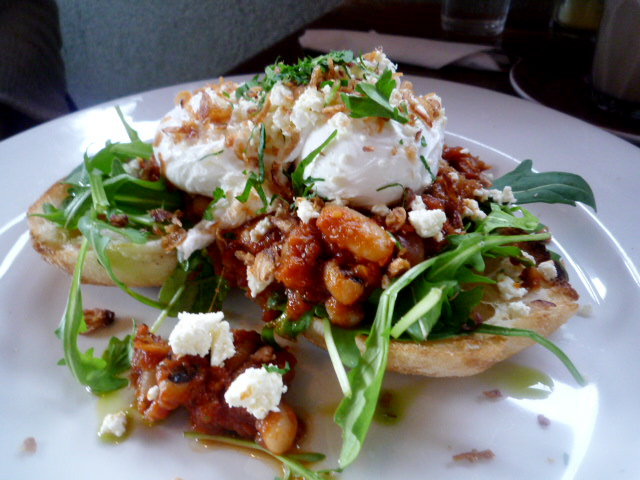 Poached eggs on turkish toast with smokey beans, chorizo, rocket, fetta and crisp shallots