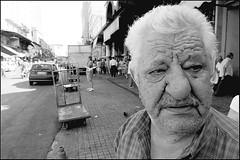 Close Up (Costas Lycavittos) Tags: street people blackandwhite bw closeup nikon athens nikkor 1224 d300 monastiraki lycavittos blackwhitephotos costaslycavittos