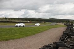 Two White Cars Speeding Past (James Simison) Tags: car race canon scotland track canon300d automotive racing circuit knockhill