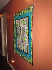 The tree quilt hangs in our hallway..