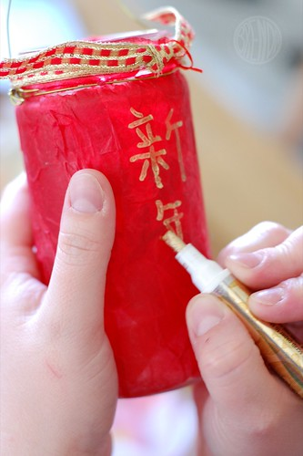 painting Chinese characters on a jar