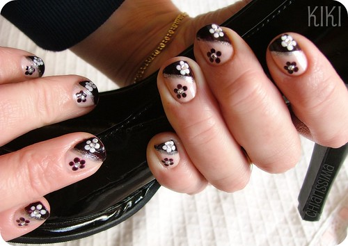 black and white flowers on my nails; ← Oldest photo