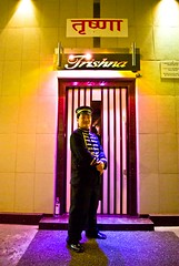 The sentinel (Mathieu [swallowed by offline life, will be back]) Tags: india restaurant guard bombay seafood mumbai sentinel doorman trishna