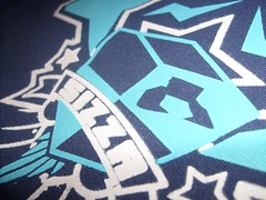 SIZZAshirt Close-up (nick knite) Tags: fashion shirt toy design tshirt crest wear sizza