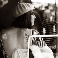 A girl from Broadway market (Che-burashka) Tags: street portrait london window girl monochrome tattoo vintage square back cafe market walk candid saturday retro east regentscanal leisure hackney beret eastlondon broadwaymarket throughtheglass
