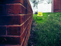 128:365 - yellow chair (cavale) Tags: sky white 3 building brick green nova grass yellow wall clouds corner fence ball virginia xpro chair shed volleyball portfolio siding reston townhouses yellowchair project365 xproaction cavalephotonet