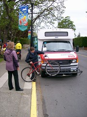 Transit operator demoing how to load bike