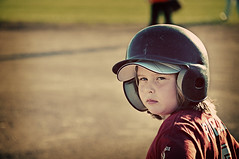 What are you looking at? (Zac Wong) Tags: old portrait chicago colour girl ball lens illinois nikon midwest soft glare little 1st d year helmet evil first 9 running run 200 stare mm softball nikkor 18 90 base 2009 league vr 18200mm d90 f3556g nikor brokeh