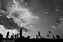 Kite Flying (Ripi) Tags: park sky people bw cloud kite silhouette flying ray kites malaysia kualalumpur beams