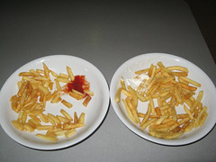 Two half-eaten plates of chips (timandpep) Tags: canon table cafe airport spain ketchup frites frenchfries chips fries catsup mayo plates malaga tomatosauce mayonnaise sachet canonpowershota560 powershota560 55tpc55