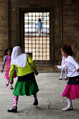 At the garden of a mosque (Electra K. Vasileiadou) Tags: travel playing turkey children nikon asia europe colours islam religion middleeast ottoman traveling sufism anatolia konya whirlingdervishes mevlana greekphotographers ηλέκτρα έλληνεσφωτογράφοι d3100 electravk