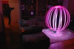 "Orbing In The Living Room (Ry"") Tags: longexposure pink light selfportrait lightpainting strange self fun interesting nikon vivid orb spooky flashlight scared speedlight strobe sb800 colorgels d80 strobist lightorb lightjunkies cybersync"