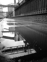 Spiegelung bw (realwidia) Tags: blackandwhite bw reflection rain metal essen industrial metall ruhrgebiet regen steal zechezollverein reflektion pfütze industriekultur schwarzweis