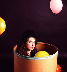 outake 238 (miriness) Tags: portrait silly girl blackbackground balloons fun funny tophat colourful studioportrait clownmakeup sittinginabox behavinglikeakid