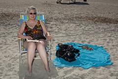 Older woman sitting in beach chair_090602_MG_7544 (Greg Ceo) Tags: portrait beach ga photo tybeeisland savannah stockphotography rightsmanaged gregceo maturesenior6575womancaucasianbeachchairreadingbeachblanket