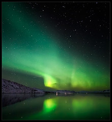 Dancing on the Lake (orvaratli) Tags: travel sky lake cold reflection green stars landscape frozen iceland space reflected aurora northernlights auroraborealis borealis icelandic ingvallavatn solarstorm magneticstorm earthandspace competition:astrophoto=2009 arcticphoto rvaratli orvaratli