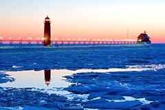 Grand Haven Sunset (johndykstraphotography) Tags: sunset sky lighthouse water pier michigan grandhaven sihloutte grandhavenmichigan digitalcameraclub