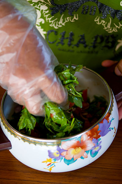 Mixing saa, a local 'salad' of fresh greens, Mae Hong Son