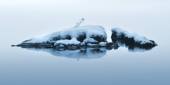 Cold Island (Jokull) Tags: snow ice cold water rocks reflection blue white still calm peacefull winter iceland thingvellir 2009 jokull island photograph photo icelandic cometoiceland traveltoiceland
