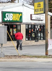 Did Jerad walk to Subway when he lost his weight? (kennethkonica) Tags: windows red usa white green yellow subway fun outdoors indianapolis fat indiana ground wires signage poles activity obese hoosiers fatso fatamerica