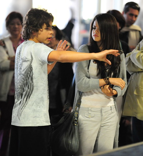 Selena Gomez And Co-Star Jake Austin Stay Close At LAX
