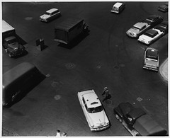 Traffic Intersection One - View from Above, Traffic Stand in Center, Three Trucks, a Delivery Van, Two Station Wagons and Taxi Pointed in Different Directions, Two People Crossing, Cars Parked Three Deep (MIT-Libraries) Tags: pedestrians vans trucks automobiles taxicabs cityplanning massachusettsinstituteoftechnology documentaryphotography urbanareas bostonmass cityandtownlife urbanplanningandenvironment kepeslynchphotographcollection urbanlanduse xmlns:dcterms=httppurlorgdcterms trafficintersections standssupportfurniture dcterms:identifier=httphdlhandlenet1721335492