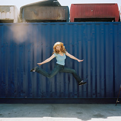 JUMP caitlin sold her car (laurenlemon) Tags: ca 6x6 film rolleiflex mediumformat caitlin la jump jumping 120film junkyard expired kodakportra160vc 2010 sunflare jumpology laurenrandolph caitlinrandolph laurenlemon wwwphotolaurencom