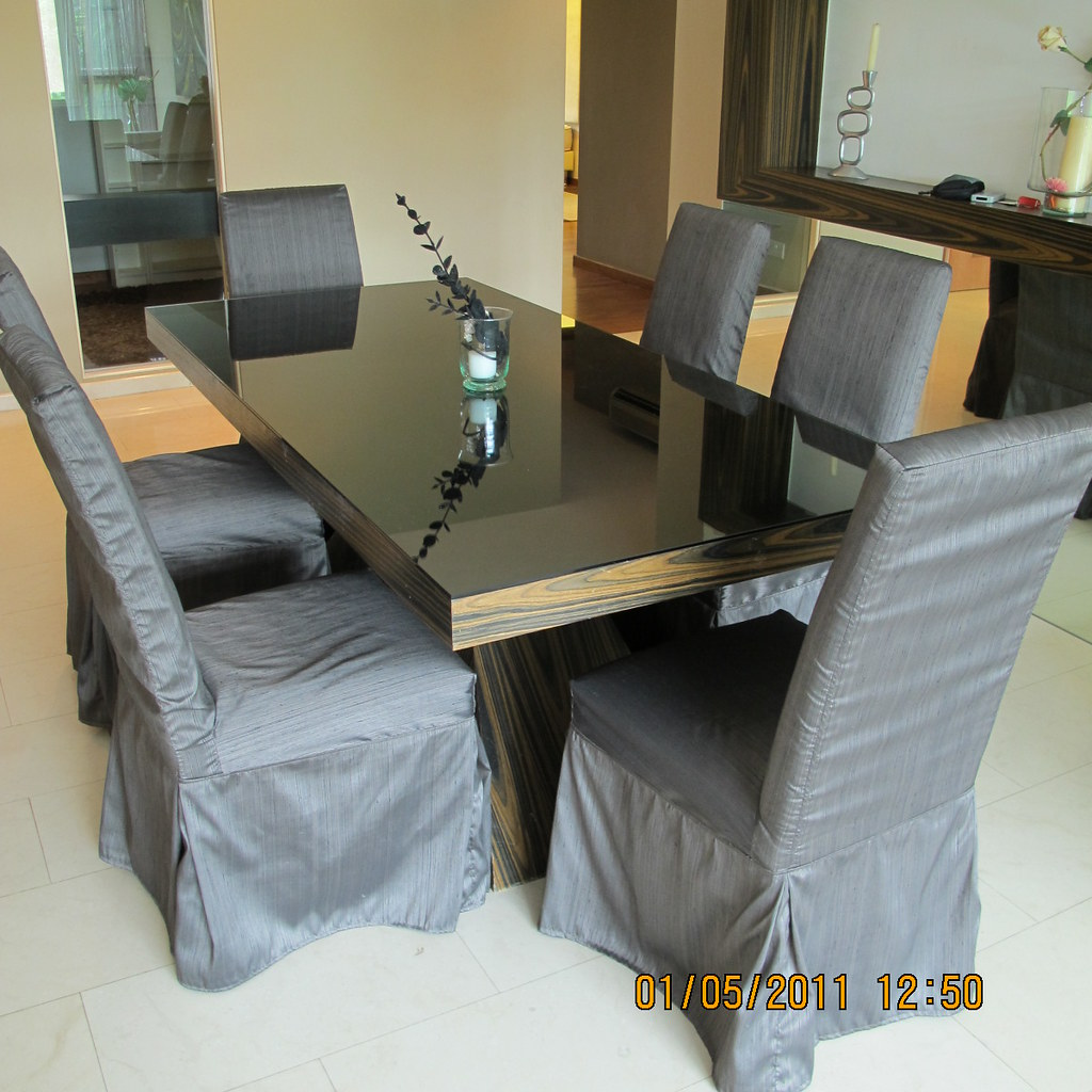 Teak Dinning Table with glass top & 6 Chairs - 1000 SGD