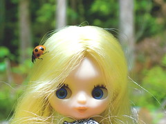 Lily with a ladybug