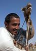 Rashaida, a camel seller in Al Ain, Emirates (Eric Lafforgue) Tags: man smile canon market muslim islam uae arabic emirates camel arabia oman ramadan homme dromadaire chameau omani 9431 lafforgue arabianpeninsula سلطنةعُمان ericlafforgue