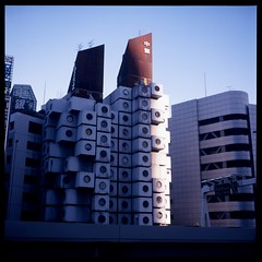 Boxed (gullevek) Tags: blue sky building 6x6 japan architecture geotagged iso100 tokyo fuji 日本 東京 expired housebuilding kishokurokawa expiredfilm 黒川紀章 汐留 港区 nakagincapsuletower rolleiflex28c epsongtx900 geo:lat=35665715 中銀カプセルタワービル geo:lon=139762662 fujimultispeed1001000