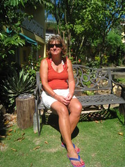 Sitting pretty (copperbottom1uk) Tags: feet smile sunglasses flip flipflops flops