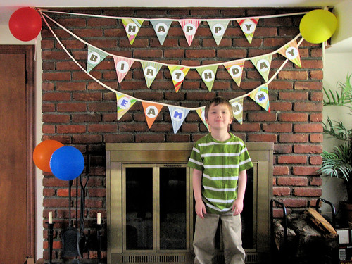 Birthday boy & his banner