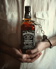 Enslaved (JenniPenni) Tags: whiskey alcoholism alcohol sickness jackdaniels addiction handcuffs