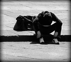 Despite the sun... (Lilith Ecate) Tags: boy shadow portrait bw square ombra sombra bn boring sit bologna sentado piazza desperation sorrow ritratto noia piazzamaggiore bolognese ragazzo sentarse seduto disperazione angoscia sedersi dispiacere