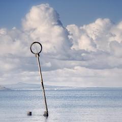 φ ([c-h-i]) Tags: blue sea sky water clouds nikon chi portobello groyne muted 28200mm f3556d forgottolowertheiso