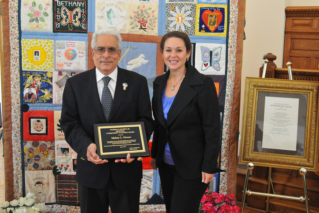 2009 Victims' Rights Week: Kristin Fleckenstein presented an award to Mohan Grover